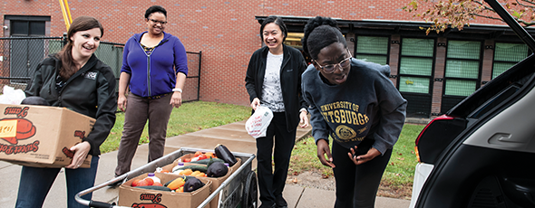 Helping the Greater Pittsburgh Community Food Bank Produce to People program: from left to right, Jen Mihalo, Erica Hampton, Thuy Bui, and Ayo Ifidon.