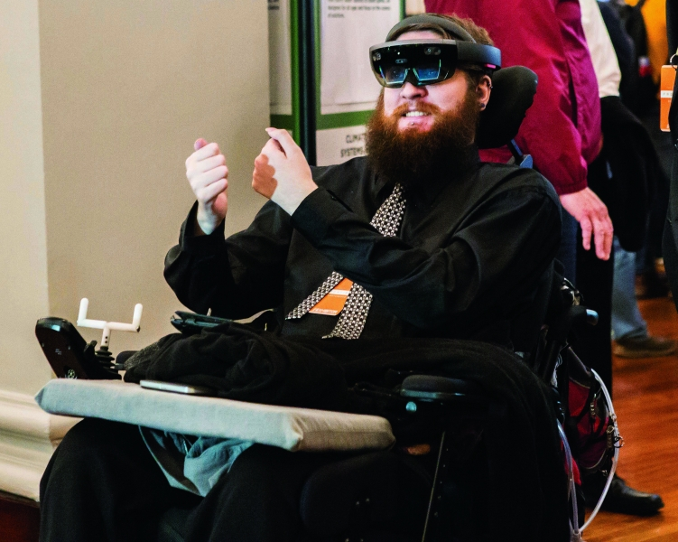 Copeland checks out a virtual reality simulation (unrelated to the brain-computer interface he's testing).