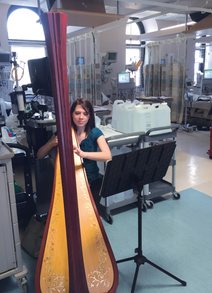 Harpist Audrey Kindsfather performs in the dialysis unit at UPMC Presbyterian.