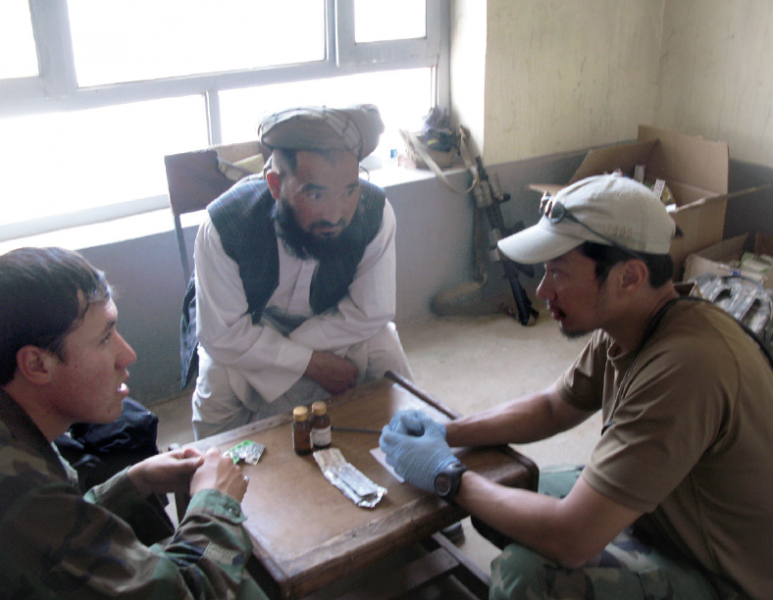 Oak sees patients at a clinic in Afghanistan.