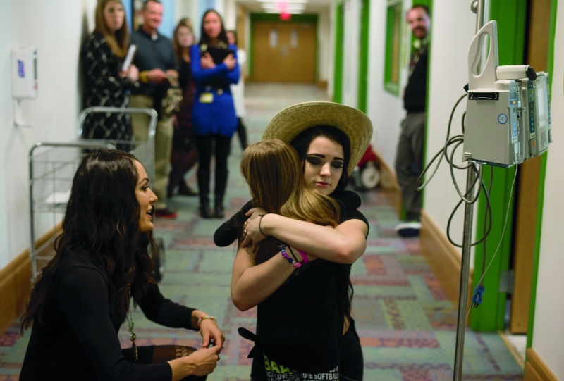 Paige hugs Addison Mercurio.